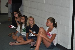 Callie Caylor, Megan Miller, Joely Craver, and Morgan Wilderman wait patiently for their turn with the Visual Arts judge