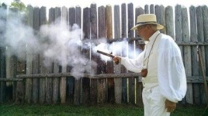 Bill Johnson fires a Hills Fort-era weapon during Heritage Days Saturday at the American Farm Heritage Museum.