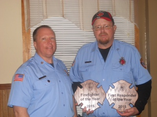Keyesport Fire Chief Jim Golder presents Jim Edwards with the First Responder and Firefighter of the Year Award.