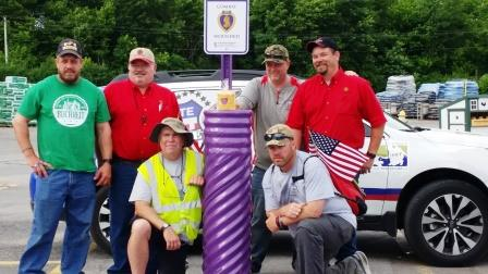 The Helping Hands for Freedom group stopped by Greenville Buchheit to see the store's Purple Heart parking space.