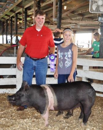 Cecelia Richter was presented with the Champion Market Gilt award by Don Henrichs of Farm Credit Illinois.  Richter was won Champion Junior Showmanship.
