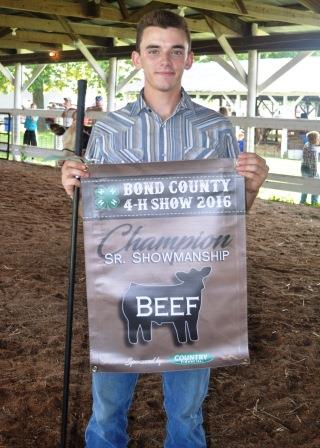 Clayton Schrumpf was named the Champion Senior Showman this year.  He received a trophy banner to hang at his stalls in the beef barn.